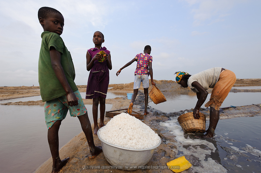 "A family harvesting salt from one of their ""atsiakpo"" pans."