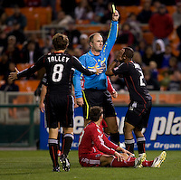 Referee Silviu Petrescu gives a yellow card to Julius James (2) of DC United for a foul on Krzysztof Krol (23) of the Chicago Fire at RFK Stadium in Washington, DC.  The Chicago Fire defeated DC United, 2-0.