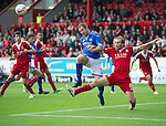 Aberdeen v St Johnstone...31.08.13      SPFL<br /> Russell Anderson clears from Frazer Wright<br /> Picture by Graeme Hart.<br /> Copyright Perthshire Picture Agency<br /> Tel: 01738 623350  Mobile: 07990 594431