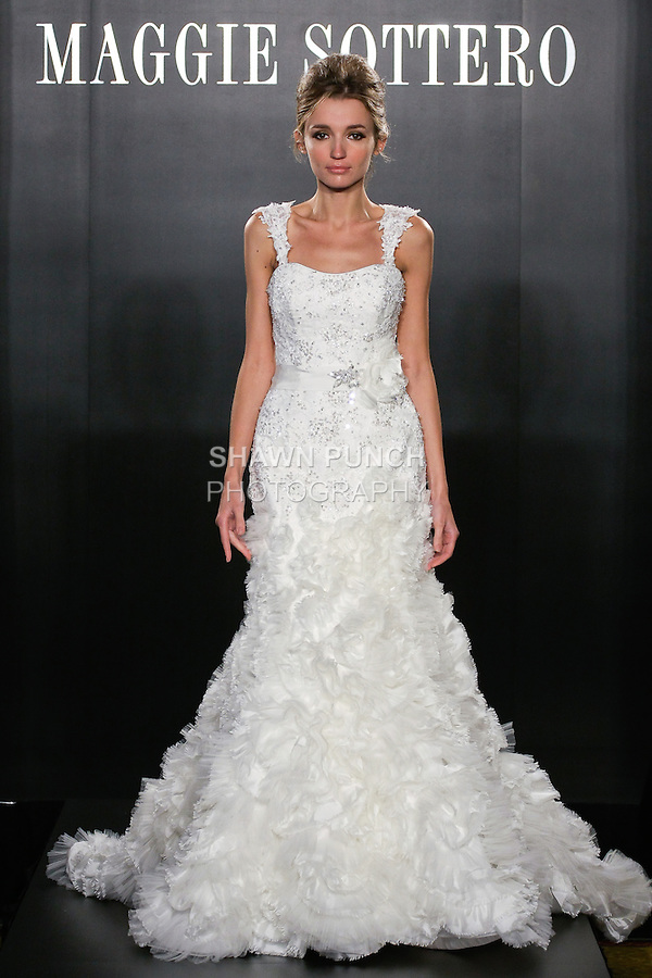 Model walks the runway in a Lacey Haute Couture wedding dress from the Maggie Sottero Bridal Spring 2012 collection, during  Couture: New York Bridal Fashion Week 2012