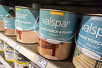 Cans of Valspar brand paint is seen in a hardware store in New York on Monday, March 21, 2016. Sherwin-Williams acquired Valspar in a deal worth approximately $11.3 billion. (© Richard B. Levine)