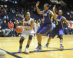 "Ole Miss's Kayla Melson (20) vs. LSU's Katherine Graham (1) and Latear Eason (3) on Sunday, January 17, 2010 at the C.M. ""Tad"" Smith Coliseum in Oxford, Miss. Ole Miss won 80-71."