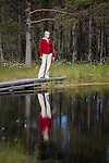 Young Woman Standing by Viru Bog Lake, Lääne-Viru County, Estonia, Europe