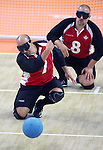 Mario Caron (7) of St. Eustache, Que. takes a shot in goalball action against the United States at the Paralympic Games in Beijing, Monday, Sept., 8, 2008.  Behind Caron is Jeff Christy of Kemptville, Ont..    Photo by Mike Ridewood/CPC