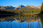 Hallett Peak and surrounding peaks reflecting in Lake Bierstadt during sunrise, Rocky Mountain National Park, Colorado.