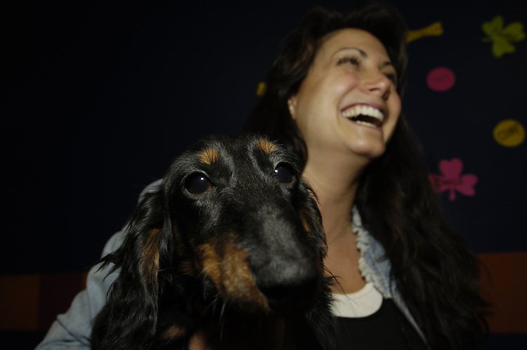 A docksin and Lisa Schreiber owner of Wag Time spend some time together.