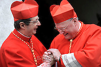 Cardinal Giovanni Lajolo , Cardinal Timothy Michael Dolan  , Pope Benedict XVI leads the Consistory where he will appoint 22 new cardinals on February 18, 2012 at St Peter's basilica at the Vatican.