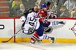 10 April 2010: Toronto Maple Leafs' left wing forward Viktor Stalberg is checked by Montreal Canadiens' defenseman Marc-Andre Bergeron in the first period at the Bell Centre in Montreal, Quebec, Canada. The Maple Leafs defeated the Canadiens 4-3 in sudden death overtime. Mandatory Credit: Ed Wolfstein Photo