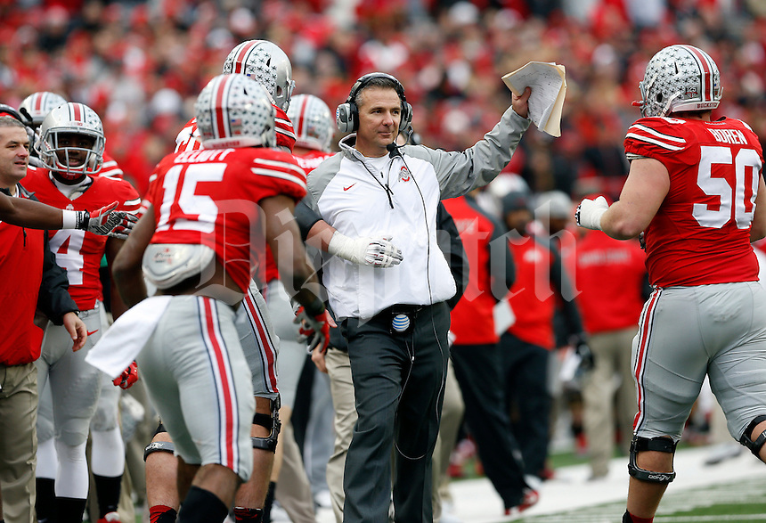 Ohio State players celebrate a touchdown by running back Ezekiel Elliott (15) with head coach Urban Meyer and offensive lineman Jacoby Boren (50) during the 4th quarter of the NCAA football game at Ohio Stadium on Nov. 29, 2014. (Adam Cairns / The Columbus Dispatch)