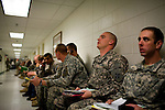 Soldiers sit in the hall of Fort Carson's Soldier Readiness Processing facility where they will receive medical and psychological screens.  Soldiers are processed through the facility after returning to Fort Carson from war or initially upon being assigned to the post...Major General Mark Graham and his wife, Carol, talk about the deaths of their two sons in their Fort Carson home in Colorado Springs, Colo.  Their son, Second Lt. Jeff Graham was killed by a roadside bomb in Iraq just months after their other son, ROTC Cadet Kevin Graham, committed suicide in his apartment.  Since Kevin's suicide, the Grahams have been outspoken advocates for suicide prevention.
