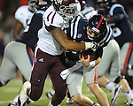 Ole Miss quarterback Bo Wallace (14) is tackled by Texas A&amp;M defensive lineman Damontre Moore (94) at Vaught-Hemingway Stadium in Oxford, Miss. on Saturday, October 6, 2012. Texas A&amp;M rallied from a 27-17 4th quarter deficit to win 30-27.
