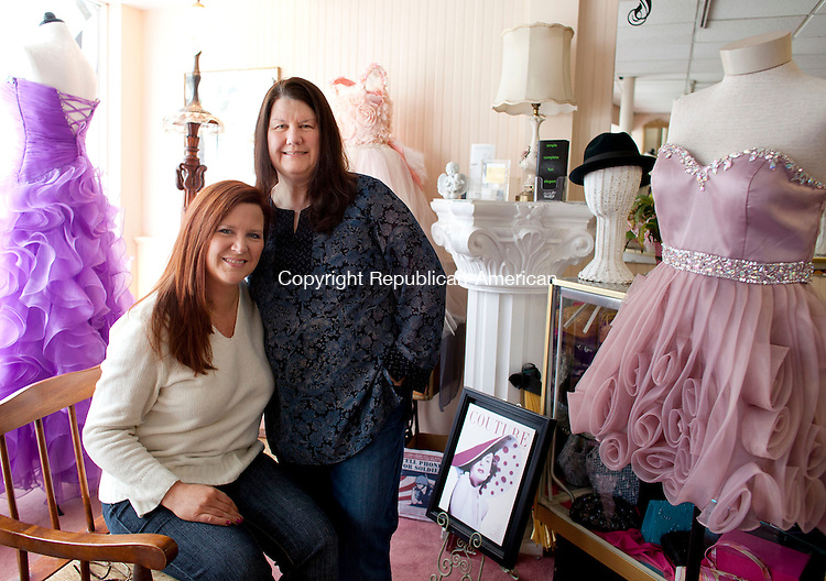 WATERTOWN, CT-5 February 2014-020514BF04-  Sisters Natalie Testa, owner of Ragtime Boutique, left, and Gail Capolupo, owner of My Sister's Baggage pose for a portrait inside Ragtime Boutique in Watertown. The two take older wedding gowns and other items and repurpose them into purses, bags, bridal garters baptism gowns and handkerchiefs.  Bob Falcetti Republican-American