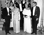 United States President John F. Kennedy, right, and first lady Jacqueline Bouvier Kennedy, left center, pose with Grand Duchess Charlotte of Luxembourg, right center, and her son Prince Jean, left, at a White House State Dinner in honor of the Grand Duchess in Washington, D.C. on April 30, 1963.  U.S. Vice President Lyndon B. Johnson is in the second row center..Credit: Arnie Sachs / CNP