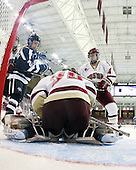 Molly Morrison (UNH - 21), Molly Schaus (BC - 30), Melissa Bizzari (BC - 4) - The Boston College Eagles and the visiting University of New Hampshire Wildcats played to a scoreless tie in BC's senior game on Saturday, February 19, 2011, at Conte Forum in Chestnut Hill, Massachusetts.