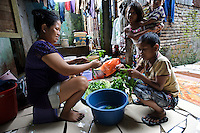 A family preparing food in an outdoor kitchen, Tallo, Makassar, Sulawesi, Indonesia.