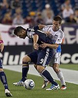New England Revolution forward Milton Caraglio (9) and San Jose Earthquakes midfielder Sam Cronin (4) battle for the ball. In a Major League Soccer (MLS) match, the San Jose Earthquakes defeated the New England Revolution, 2-1, at Gillette Stadium on October 8, 2011.