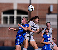 Vanessa Skrumbis (13) of Georgetown goes up for a header with Ashleigh Goddard (23) of DePaul during the game at Shaw Field on the campus of Georgetown University in Washington, DC.  Georgetown tied DePaul, 1-1, in double overtime.