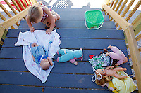 """Hailey Lansaw plays with dolls on the front porch of her grandmothers FEMA trailer on August 26, 2011. """"We were hoping to God that we got a home, so they can come here and start feeling normal again,"""" Bragole said."""