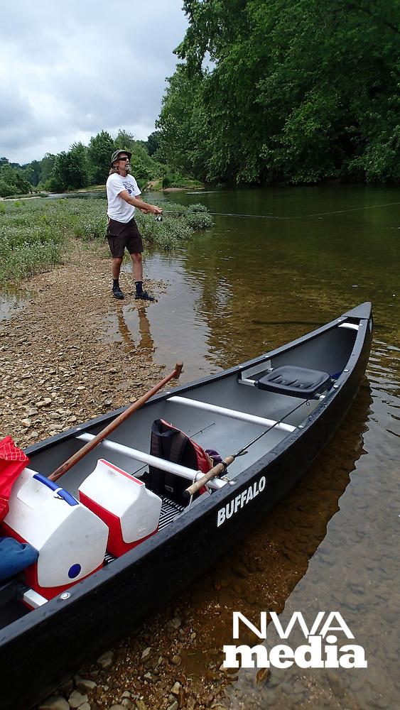 NWA Democrat-Gazette/FLIP PUTTHOFF <br /> Silcott does some wade-fishing June 9, 2016 during a Kings River float trip.