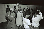 UPINGTON, SOUTH AFRICA - FEBRUARY 9: Drunk people dance in an illegal bar February 9, 2002 in Loisevale near Upington, South Africa. Loisevale is a poor and destitute black township where unemployment is high and a number of social problems exist including domestic violence and alcohol abuse. Baby Thsepang, an eight-month old baby, was raped by her father in a house on this street in October 2001. The baby rape shocked the country. South Africa is struggling with an increasing number of rapes and sexual abuse of young children. In addition, the country has the highest number of rapes in the world. (Photo by Per-Anders Pettersson)