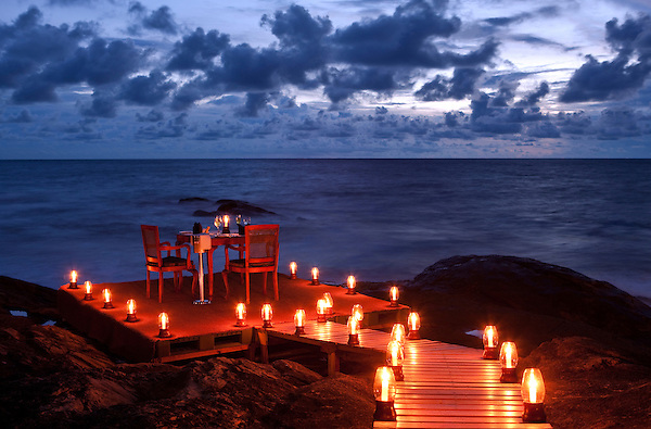 A table is set  for a ocean side candle light dinner for two at Saman Villas, Aturuwella, Bentota, Sri Lanka.