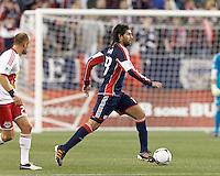 New England Revolution substitute midfielder Juan Toja (18) brings the ball forward. Despite a red-card man advantage, in a Major League Soccer (MLS) match, the New England Revolution tied New York Red Bulls, 1-1, at Gillette Stadium on September 22, 2012.