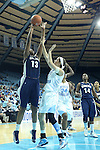 14 November 2012: Georgetown's Sydney Wilson (13) shoots over North Carolina's Megan Buckland. The University of North Carolina Tar Heels played the Georgetown University Hoyas at Carmichael Arena in Chapel Hill, North Carolina in an NCAA Division I Women's Basketball game, and a semifinal in the Preseason WNIT. UNC won the game 63-48.