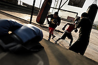 Peruvian youths practice with punching bags at the Boxeo VMT boxing club in an outdoor gym in Lima, Peru, 2 April 2013. Boxeo VMT is a grassroots organisation offering boxing lessons to youth as an alternative to gang violence, crime and drug-trafficking. Located in some of Lima's most marginalized neighborhoods, Boxeo VMT club joins nearly 50 young men. Although the club disposes only of an unequipped outdoor facility with couple of punching bags, the young boxers train hard three times a week and dream to become a boxing champion.