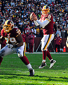 Washington Redskins quarterback Rex Grossman (8) jumps to receive the snap in late second quarter action against the New England Patriots  at FedEx Field in Landover, Maryland on Sunday December 11, 2011.  The Patriots won the game 34 - 27..Credit: Ron Sachs / CNP.(RESTRICTION: NO New York or New Jersey Newspapers or newspapers within a 75 mile radius of New York City)
