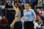 27 March 2015: UNC head coach Sylvia Hatchell (right) talks to referee Maj Forsberg. The University of North Carolina Tar Heels played the University of South Carolina Gamecocks at the Greensboro Coliseum in Greensboro, North Carolina in a 2014-15 NCAA Division I Women's Basketball Tournament regional semifinal game. South Carolina won the game 67-65.