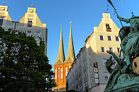 Berlin, Germany. Nikolaiviertel, Nikolai Quarter, is the reconstructed historical heart of the city. The statue of St. George Slaying the Dragon and the Nikolaikirche.