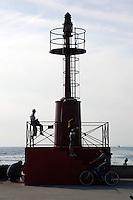Faro al porto di Fiumicino. Lighthouse in the port of Fiumicino.....