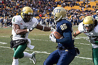 USF defensive back Mike Jenkins (4) closes in on Pitt running back LeSean McCoy (25).  The South Florida Bulls defeated the Pitt Panthers 48-37 on November 24, 2007 at Heinz Field, Pittsburgh, Pennsylvania.
