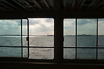 New York, USA. Statue of Liberty as seen through the window of the Circle Line boat on the Hudson River