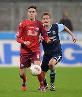 Fussball 2. Bundesliga:  Saison   2012/2013,    16. Spieltag  TSV 1860 Muenchen - SC Paderborn  27.11.2012 Mario Vrancic (li, SC Paderborn 07) gegen Kai Buelow ( 1860 Muenchen)