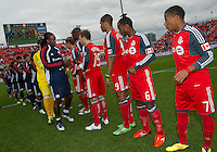 22 October 2011: New England Revolution midfielder Shalrie Joseph #21 leads his team in shaking hands with Toronto FC players at the start of a game between the New England Revolution and Toronto FC at BMO Field in Toronto..The game ended in a 2-2 draw.
