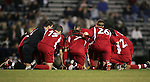 NC State's starters say a prayer before the start of the game on Friday, October 21st, 2005 at Koskinen Stadium in Durham, North Carolina. The Duke University Blue Devils defeated the North Carolina State University Wolfpack 6-0 during an NCAA Division I Men's Soccer game.