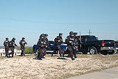 Fort Hood, TX - November 5, 2009 -- SWAT team members approach a building with a gunman inside. Thirteen people were killed and 30 more wounded in an attack by a lone gunman at Fort Hood, Texas, Thursday, November 5, 2009..Mandatory Credit: Jason R. Krawczyk - U.S. Army via CNP