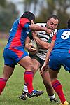 Sami Soane gets a tap on the chin from Robinson Avei as he charges upfield. Counties Manukau Premier Club Rugby game between Manurewa and Ardmore Marist played at Mountfort Park, Manurewa on Saturday June 19th 2010..Manurewa won the game 27 - 10 after leading 15 - 5 at halftime.