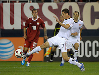 US midfielder Alejandro Bedoya (7) lunges for the ball.  The U.S. Men's National Team tied Poland 2-2 at Soldier Field in Chicago, IL on October 9, 2010.