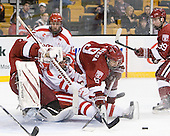 Ryan Carroll (Harvard - 35), Chris Connolly (BU - 12), Joe Pereira (BU - 6), Danny Biega (Harvard - 9), Pier-Olivier Michaud (Harvard - 39) - The Harvard University Crimson defeated the Boston University Terriers 5-4 in the 2011 Beanpot consolation game on Monday, February 14, 2011, at TD Garden in Boston, Massachusetts.