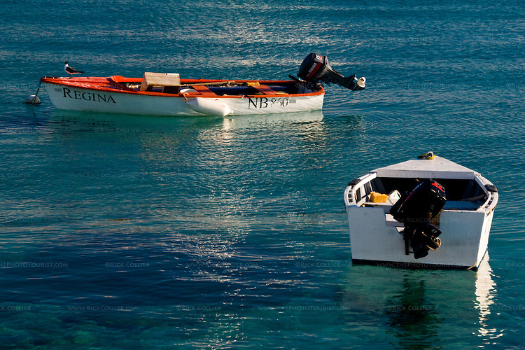 Kralendijk, Bonaire, Netherland Antilles -- Carefully maintained motor boats dot the harbor anchorage on crystal blue water at Kralendijk.