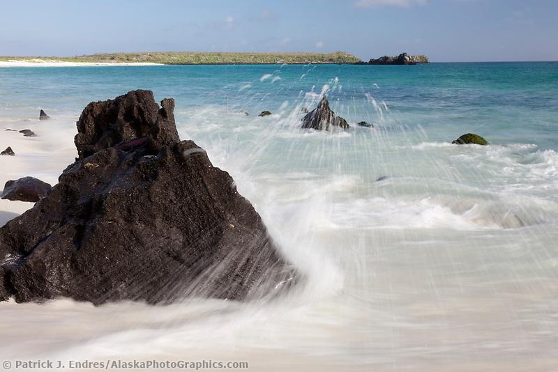 Waves crash along Gardner beach, Espanola Island, Galapagos Islands, Ecuador.