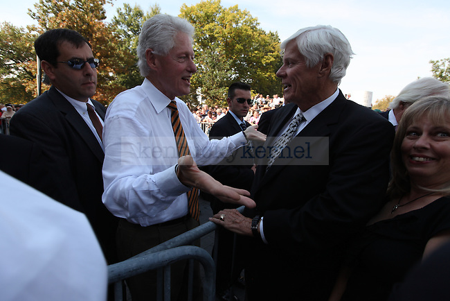 Former president Bill Clinton talks with Gov. John Y. Brown after speaking to support Jack Conway in his run for senate on Oct. 11, 2010. Photo by Britney McIntosh | Staff