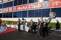 Nov 13, 2016; Pomona, CA, USA; Crew members with NHRA top fuel driver Antron Brown during the Auto Club Finals at Auto Club Raceway at Pomona. Mandatory Credit: Mark J. Rebilas-USA TODAY Sports