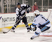 Connor Hardowa (UNH - 2), Spencer Abbott (Maine - 13) - The University of Maine Black Bears defeated the University of New Hampshire Wildcats 5-4 in overtime on Saturday, January 7, 2012, at Fenway Park in Boston, Massachusetts.