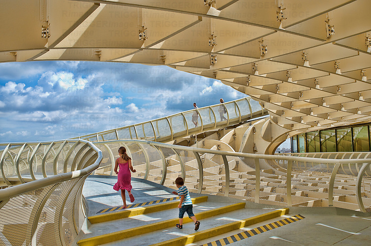Walkway on the top of Metropol Parasol structure, Seville, Spain with children