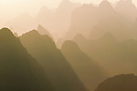 The early morning light gives the backlit ridges of the Karst Mountains a translucent quality, Guilin, China.