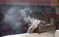 Incense burns at the Hemis Monastery.