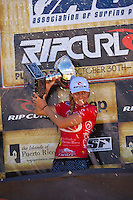 SOMEWHERE, Porta Del Sol/Puerto Rico (Monday, November 1, 2010) - Stephanie Gilmore (AUS), 22, has claimed her fourth, consecutive ASP Women's World Title, making history at the Rip Curl Women's Pro Search Puerto Rico.. .With her Quarterfinal win over Melanie Bartels (HAW), 28, Gilmore amassed enough points to knock sole remaining contender, Sally Fitzgibbons (AUS), 19, out of the running for the 2010 ASP Women's World Title Race..Newly-crowned four-time ASP Women's World Champion Stephanie Gilmore (AUS), 22, has taken out her 16th elite tour event today, defeating rookie sensation Carissa Moore (HAW), 18, in two-to-three foot (1 metre) waves in Porta Del Sol to claim the Rip Curl Women's Search Pro Puerto Rico. .Photo: joliphotos.com